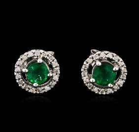 0.71ctw Emerald And Diamond Earrings - 14kt White Gold