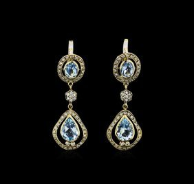 3.65ctw Blue Topaz And Diamond Earrings - 18kt Yellow