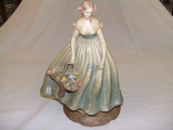 11: Grand Porcelain Figural of woman holding Basket