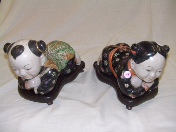 19: 2 piece asian porcelain pillows on stand