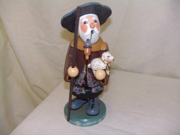 684: handmade and painted German smoker figurine comes