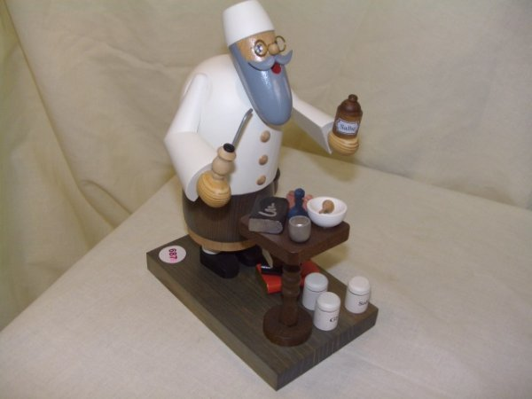 687: handmade and painted German smoker figurine comes
