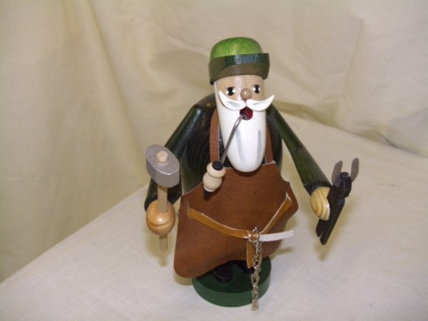 693: handmade and painted German smoker figurine comes