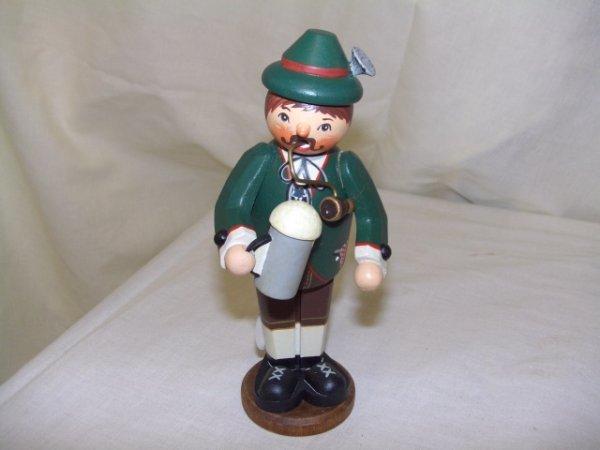 697: handmade and painted German smoker figurine comes