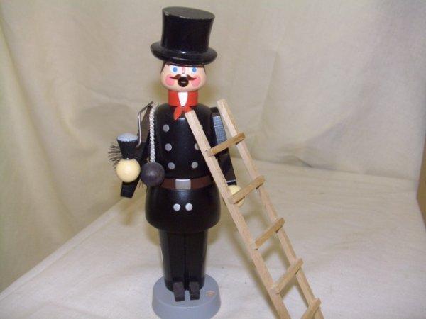 699: handmade and painted German smoker figurine comes