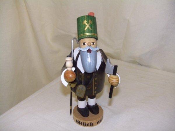 702: handmade and painted German smoker figurine comes