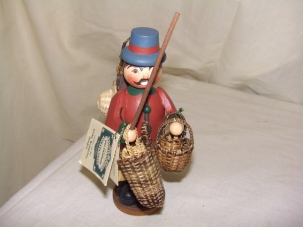703: handmade and painted German smoker figurine comes