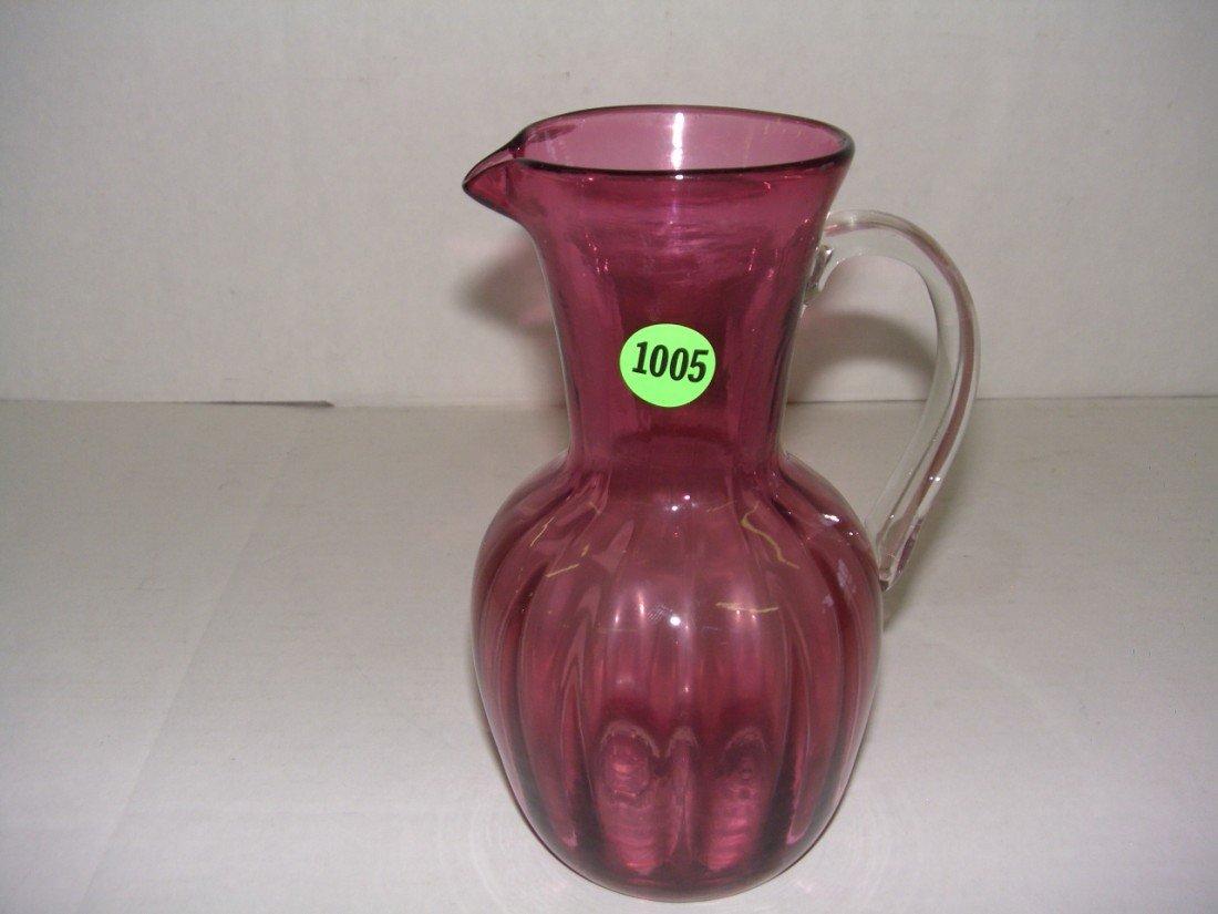 """1005: blown glass cranberry pitcher 7"""" tall"""