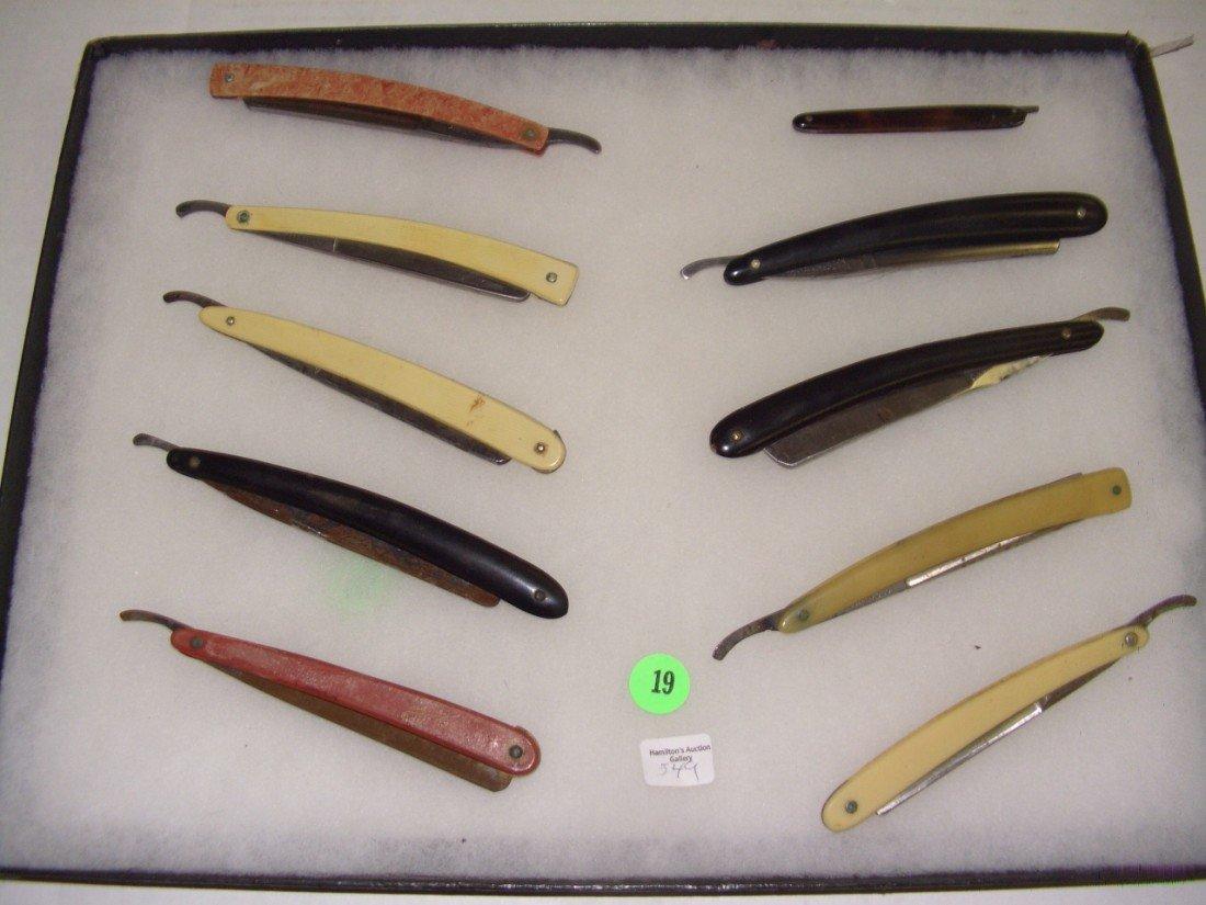 19: tray of estate straight razors