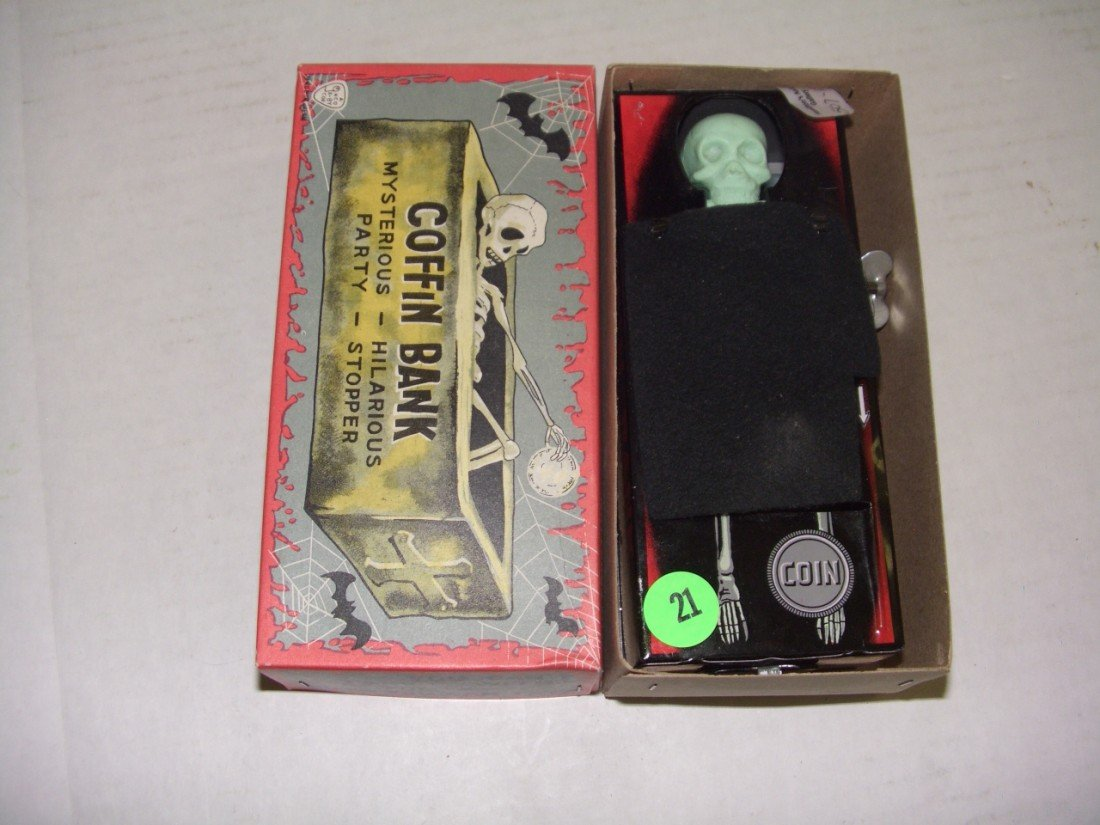 21: vintage wind up toy coffin bank with box