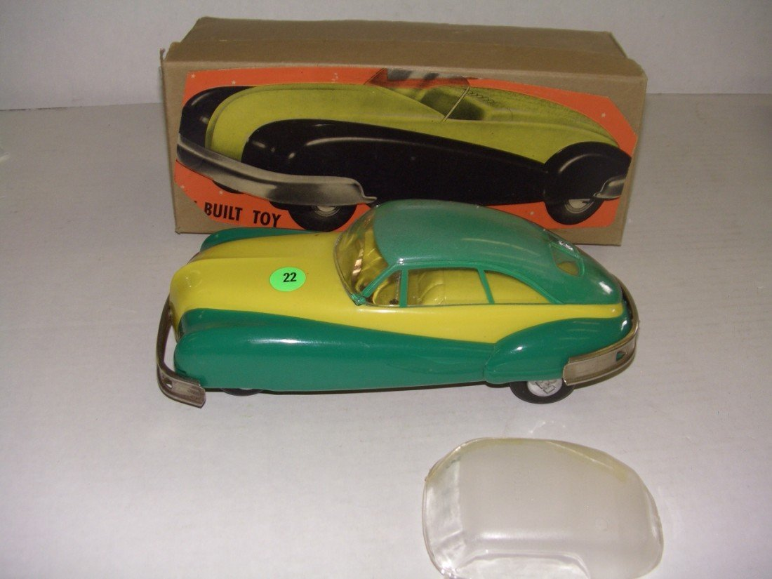 22: vintage wind up toy car with box