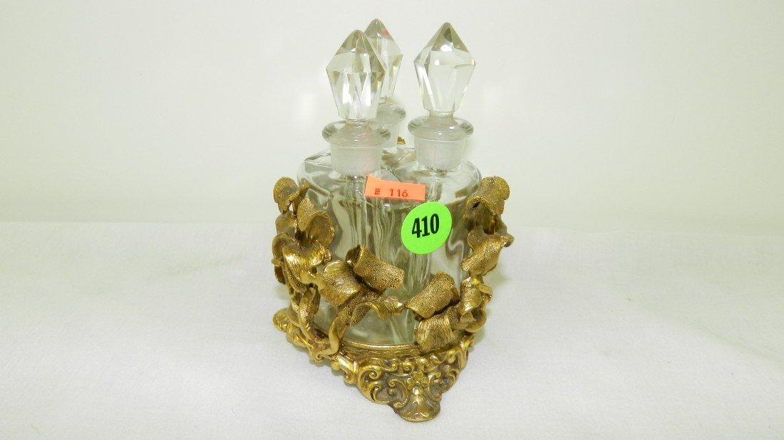410: fancy metal three bottle dresser perfume display w
