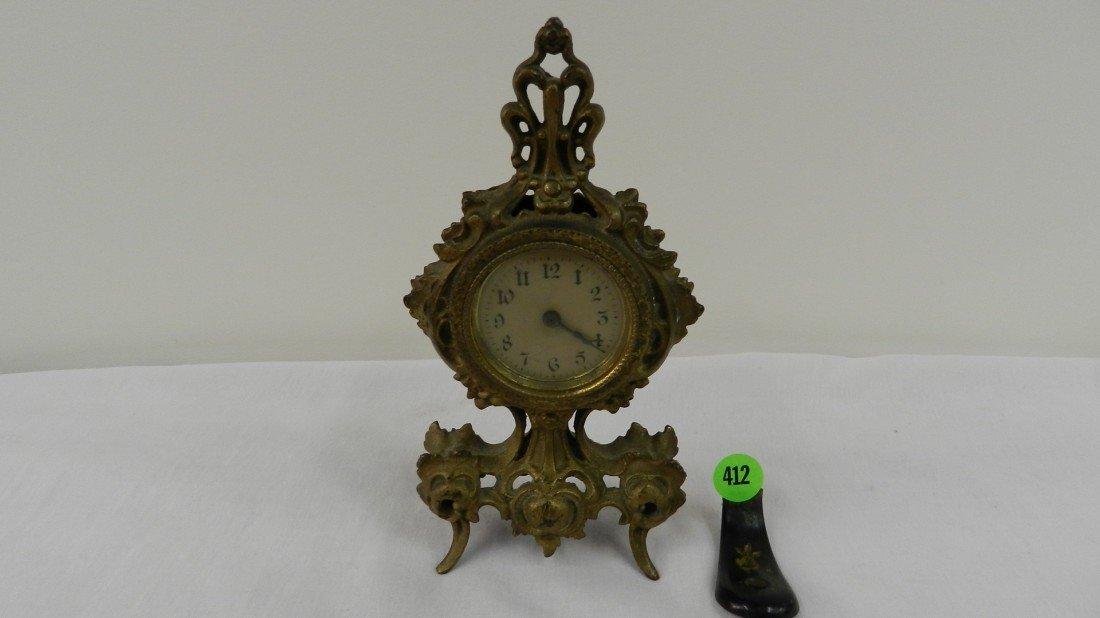 412: antique metal case bronze wash dresser wind up clo