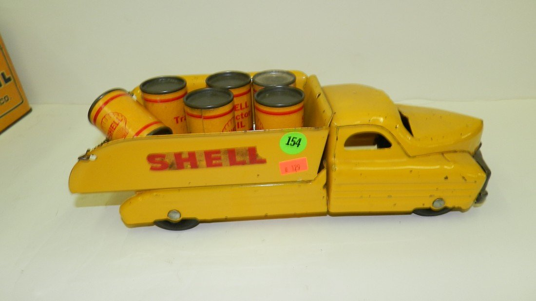 154: vintage child's metal toy Shell truck with oil can