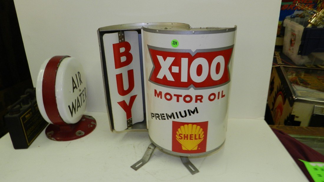 224: vintage Shell turning metal gas sign