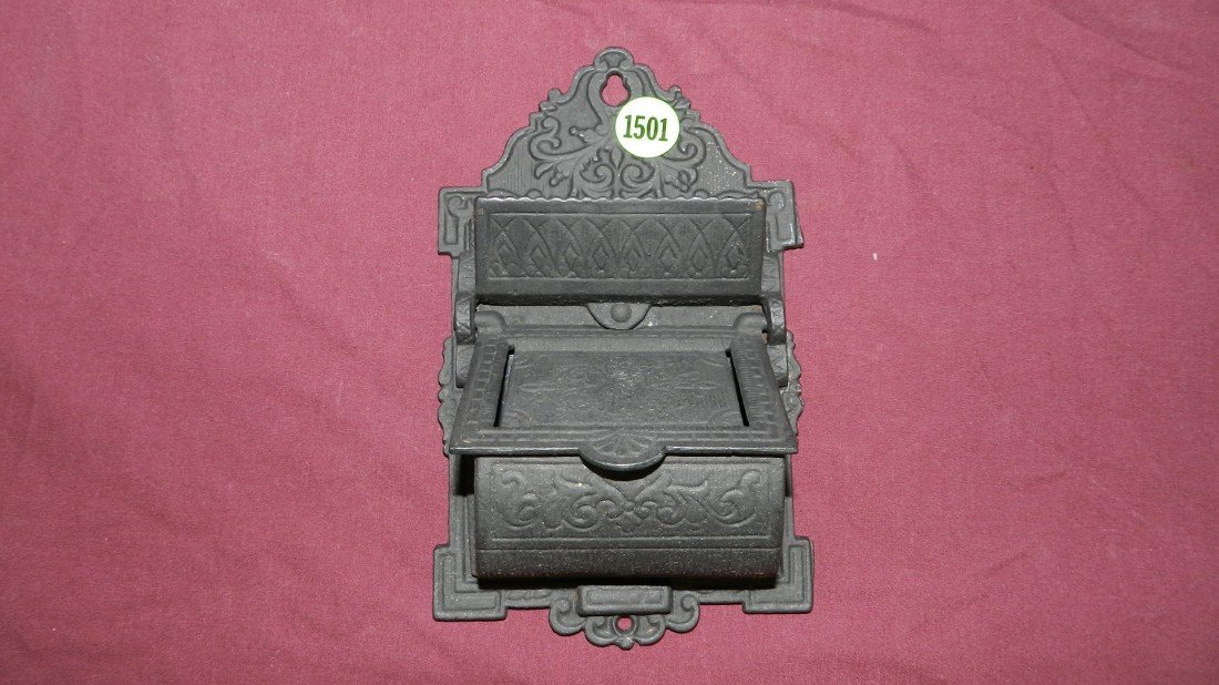 1501: cast iron wall match safe
