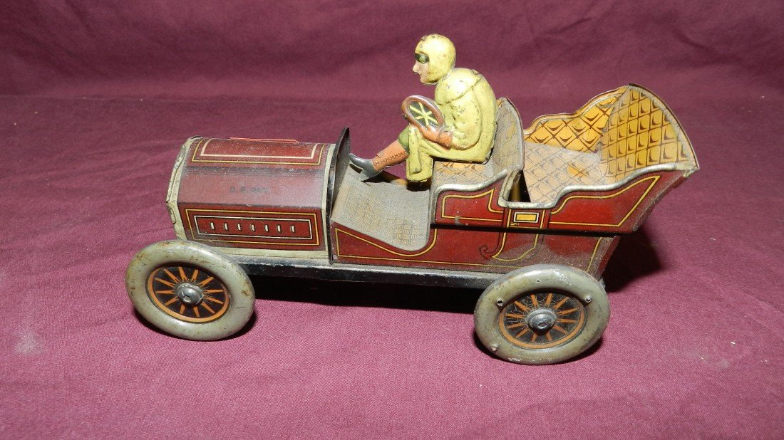 1561: amazing Lehmann tin toy wind up racer car and dri