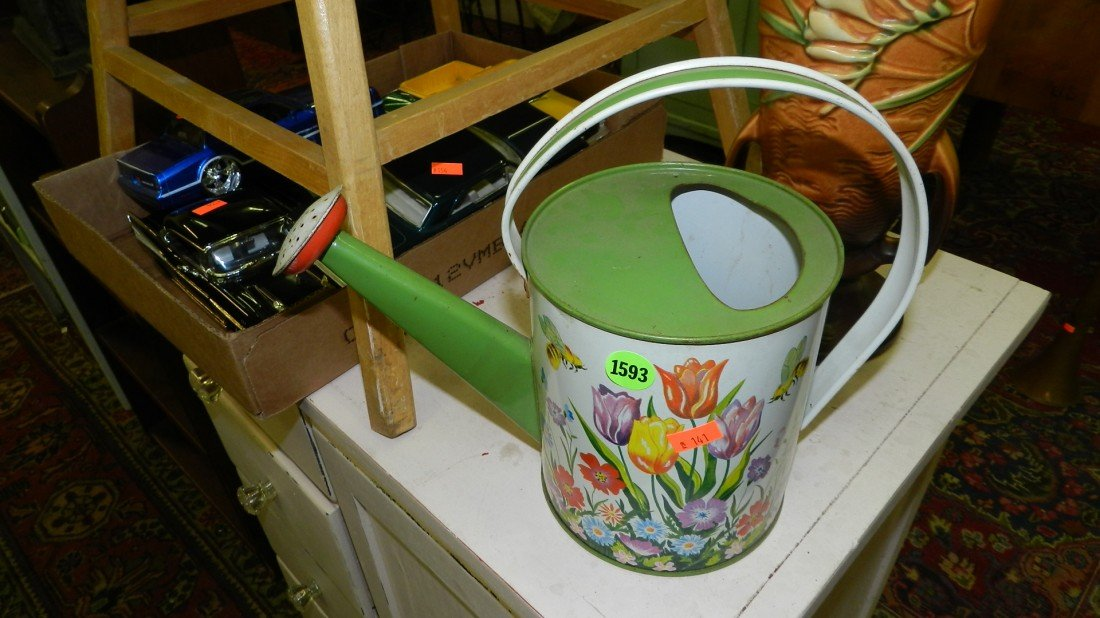 1593: child's tin watering can