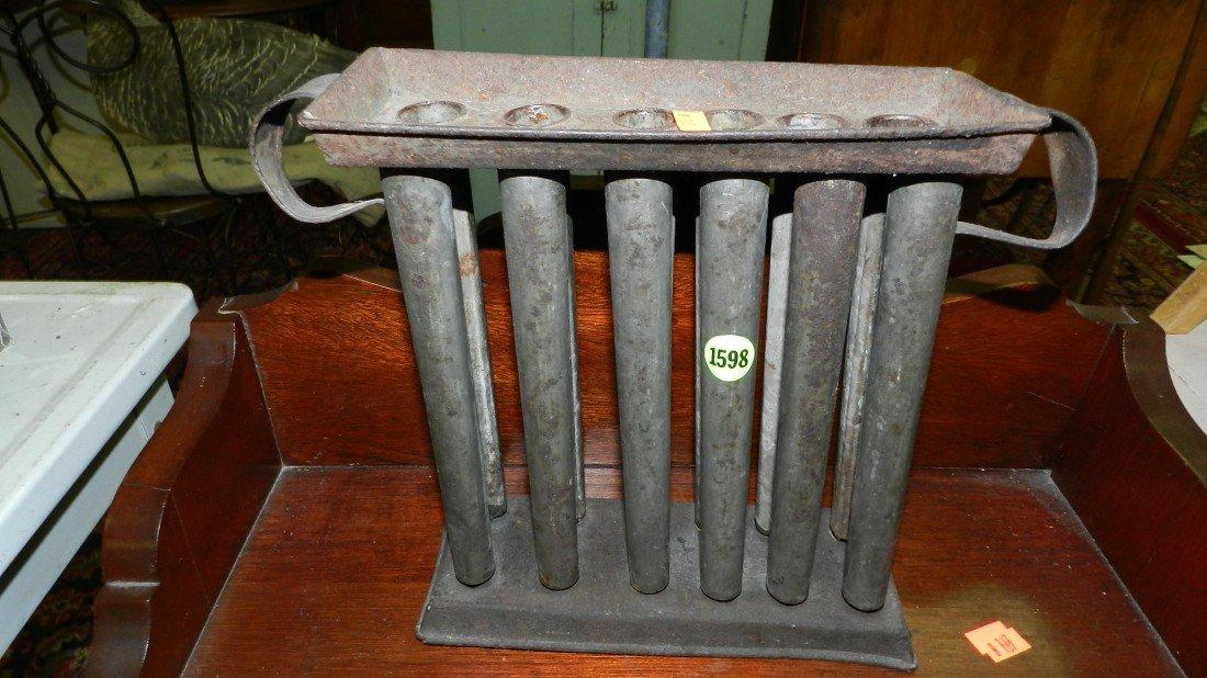1598: Primitive candle mold
