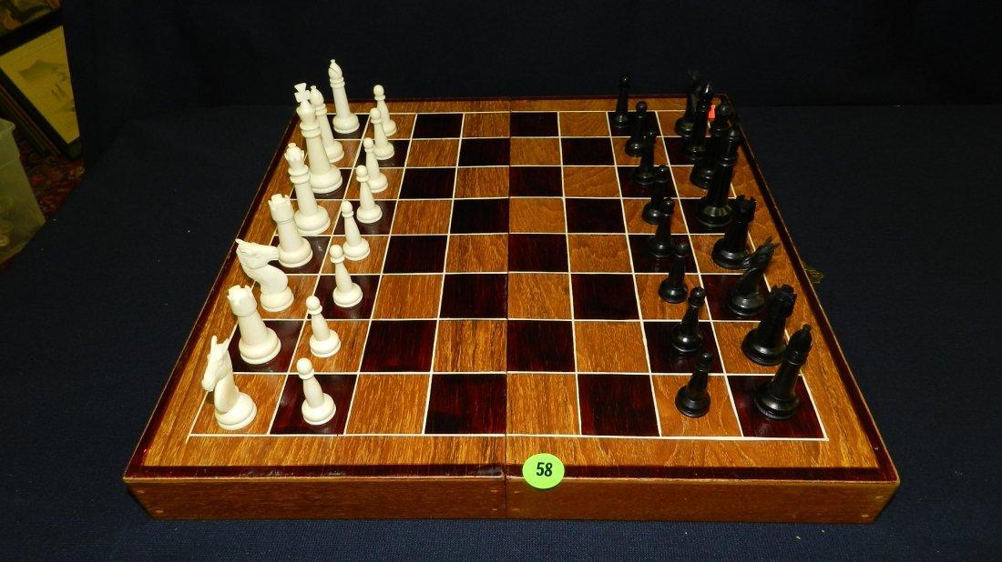 58: wonderful vintage carved Ivory and ebony chess set,