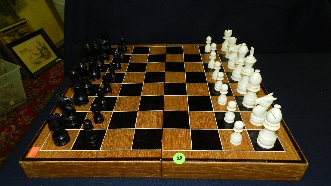 59: wonderful vintage carved Ivory and ebony chess set,