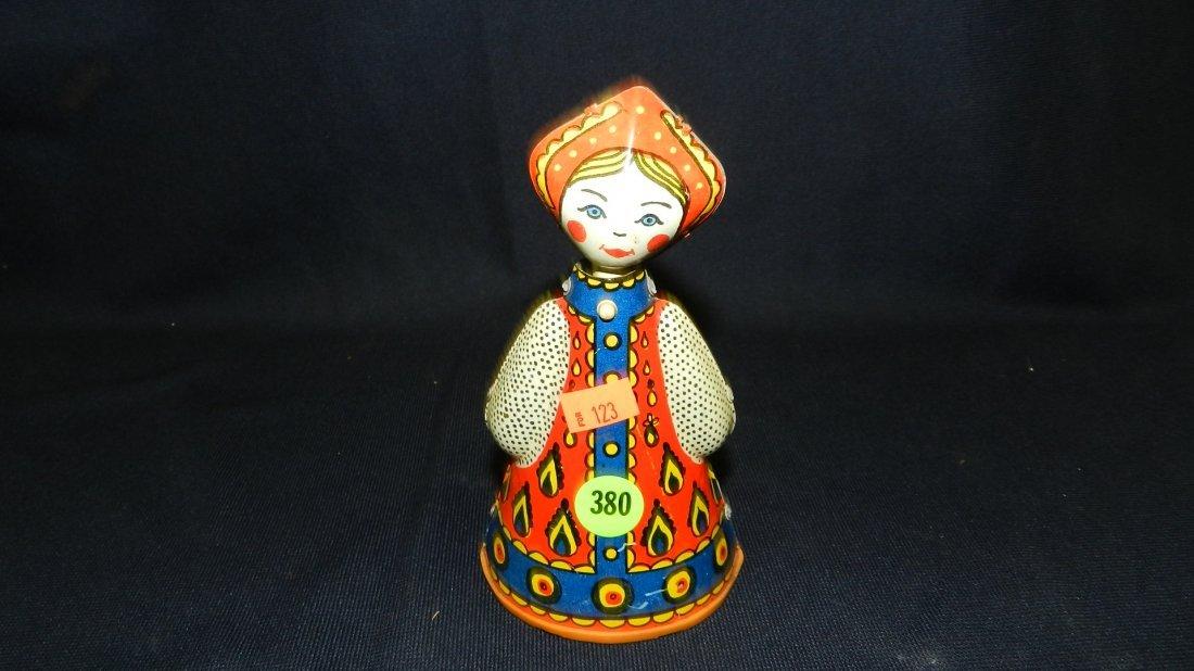 380: antiqur tin nodder rolling toy Dutch? girl