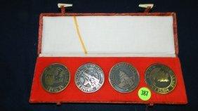 387: 4 piece Asian coins/medals?