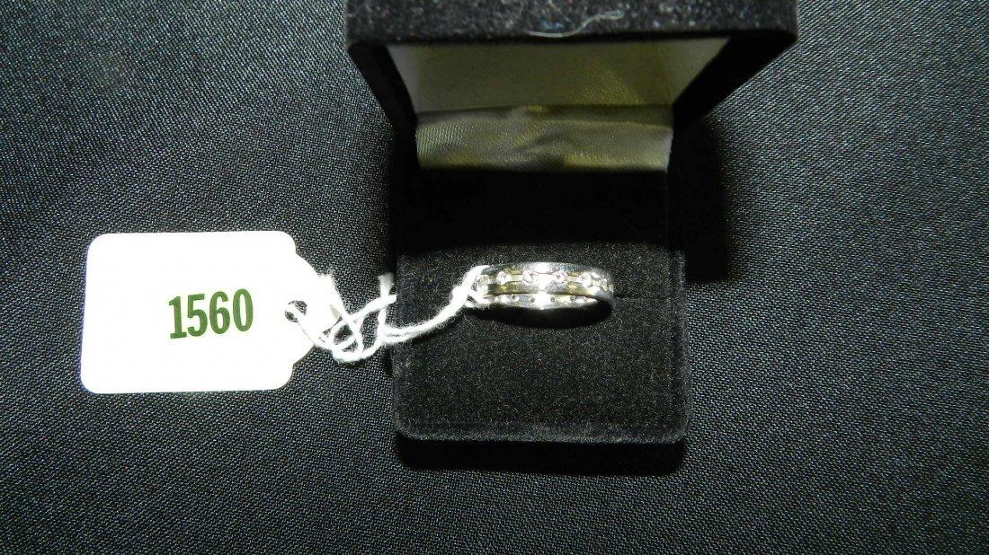 1560: stunning platinum and diamond wedding band with a