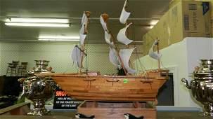 1733: large wood carved (model?) sailing ship, sails as