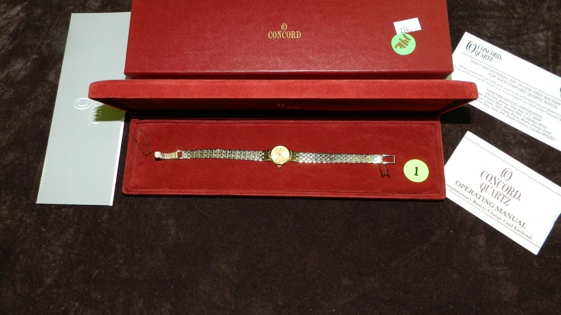 1: stunning ladies 14KT yellow gold wrist watch by Conc