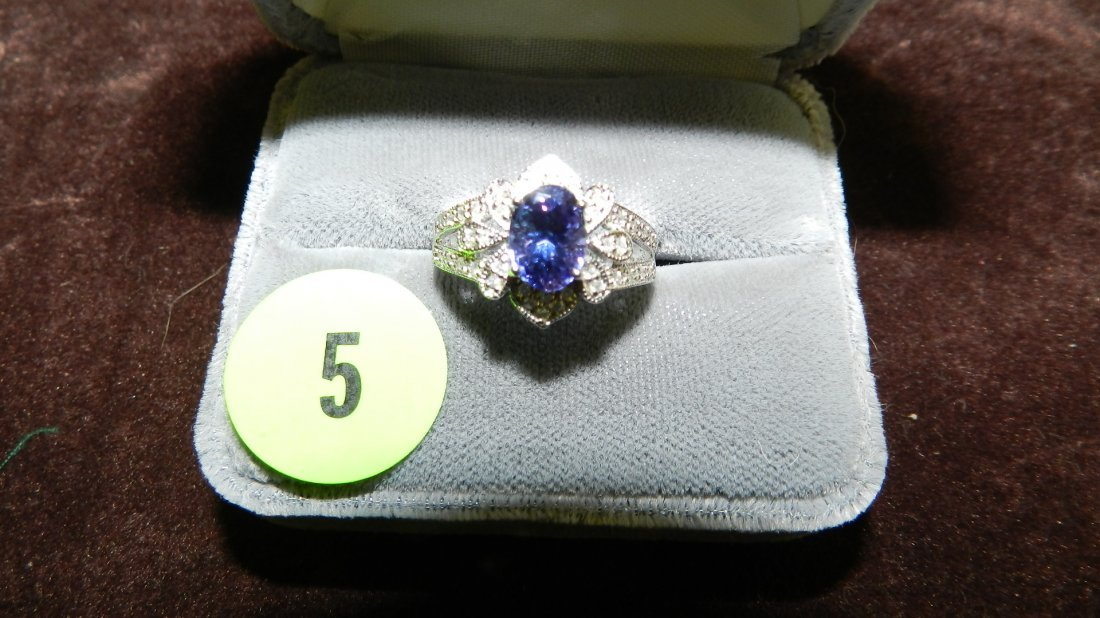 5: lovely ladies 14KT white gold and diamond ring with