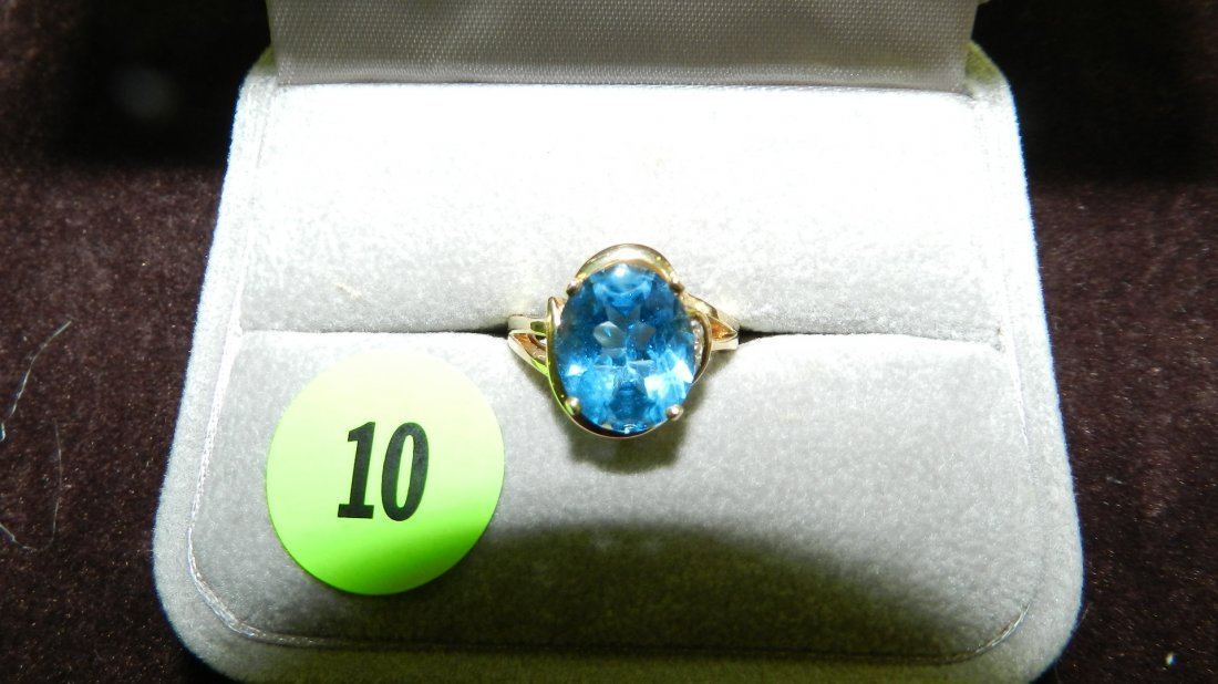 10: beautiful gold (14KT) and diamond ring with large b