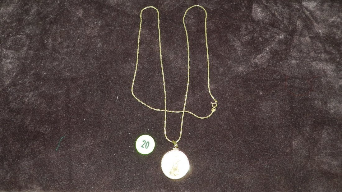20: nice ladies gold (14KT) pendant & chain with US gol