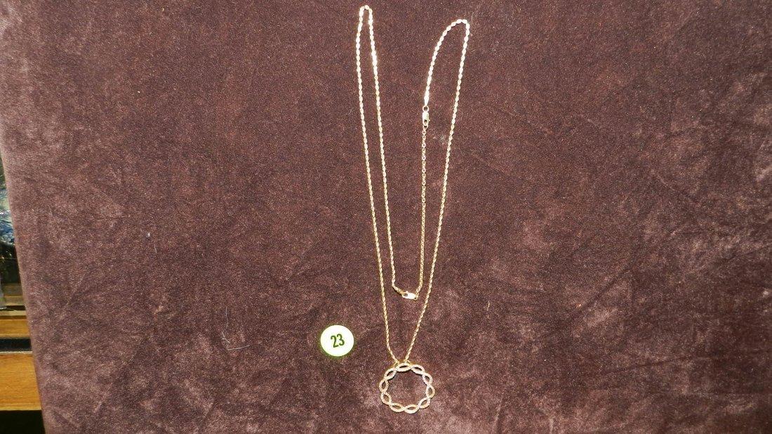23: nice ladies gold (14KT) necklace with diamond penda