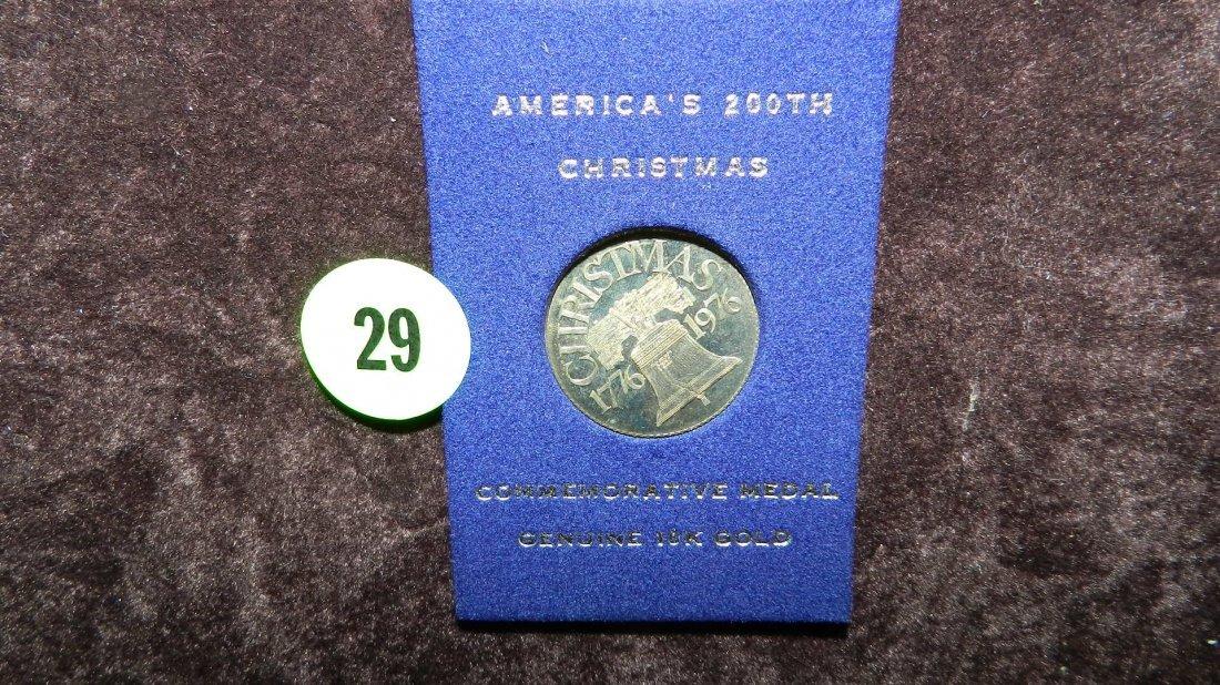 29: nice 10KT gold Christmas coin