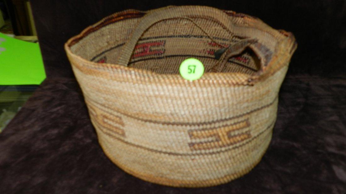 57: authentic Native American handmade woven basket / b