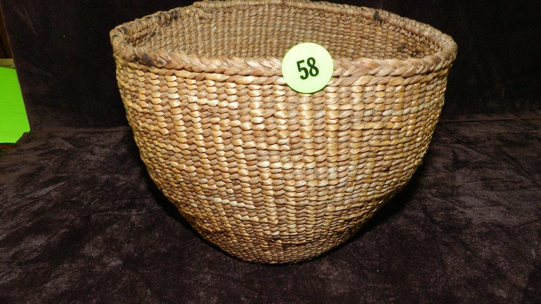 58: authentic Native American handmade woven basket / b