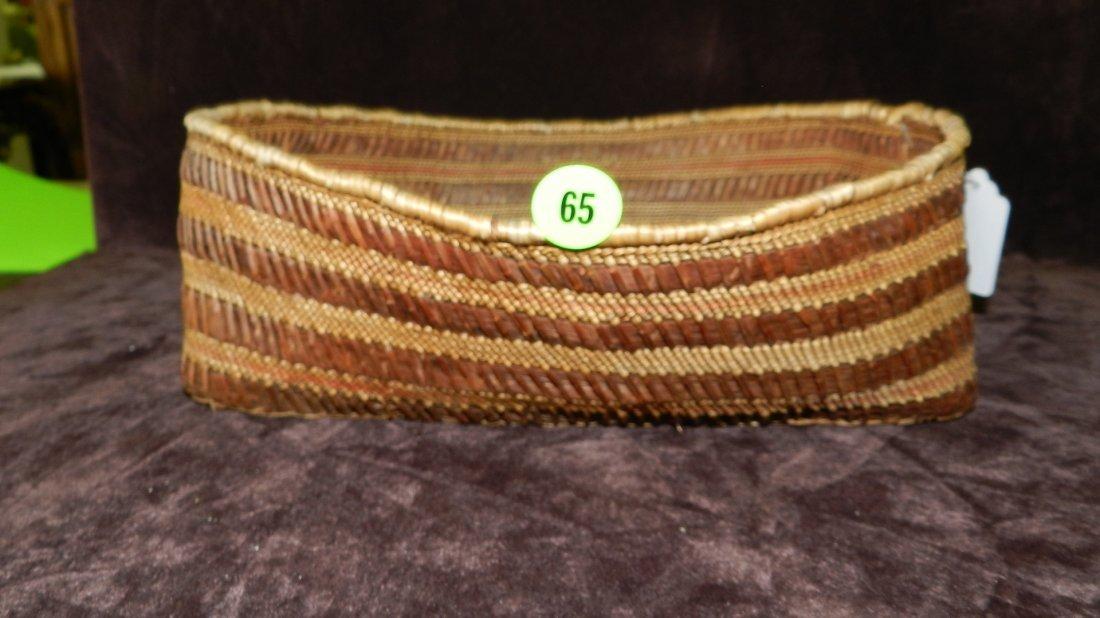 65: authentic Native American handmade woven basket / b