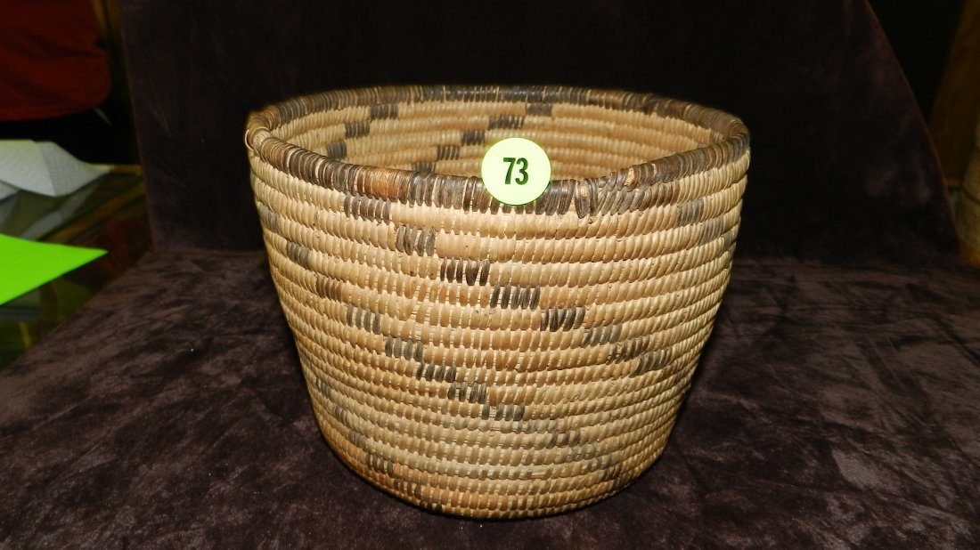 73: authentic Native American handmade woven basket, pi