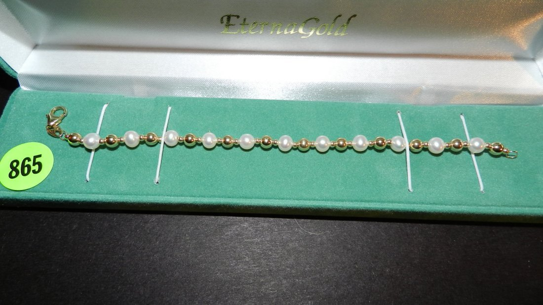 865: lovely ladies 14KT gold (stamped) bracelet with pe