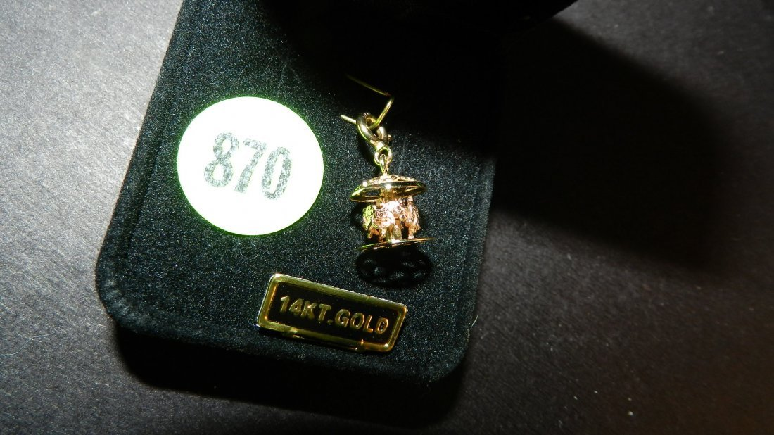 870: lovely ladies 14KT gold (stamped) carousel charm (