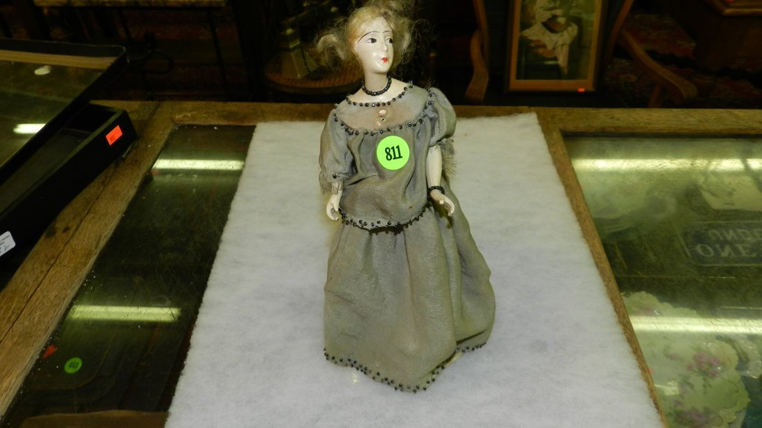 811: antique doll perfume display