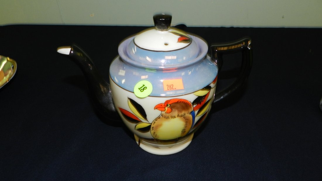 18: painted porcelain lusterware tea pot