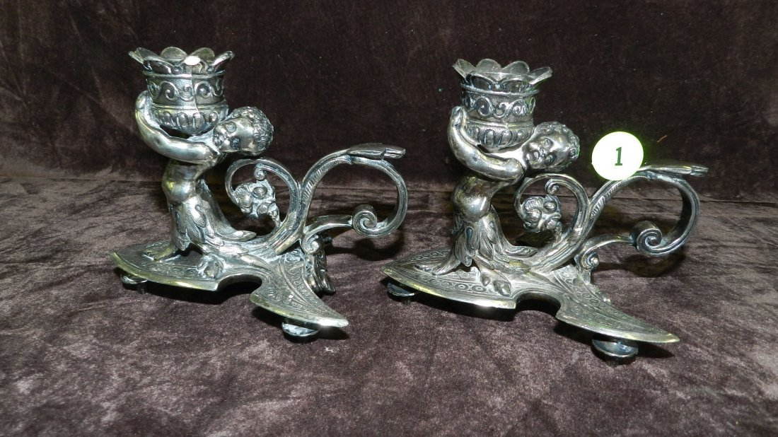 1: 2 piece antique silver plated single cherub candlest
