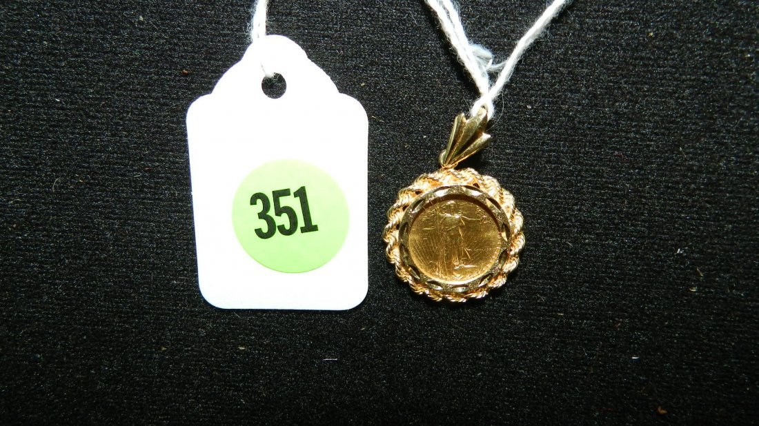 351: nice five (5) dollar gold coin with gold bezel