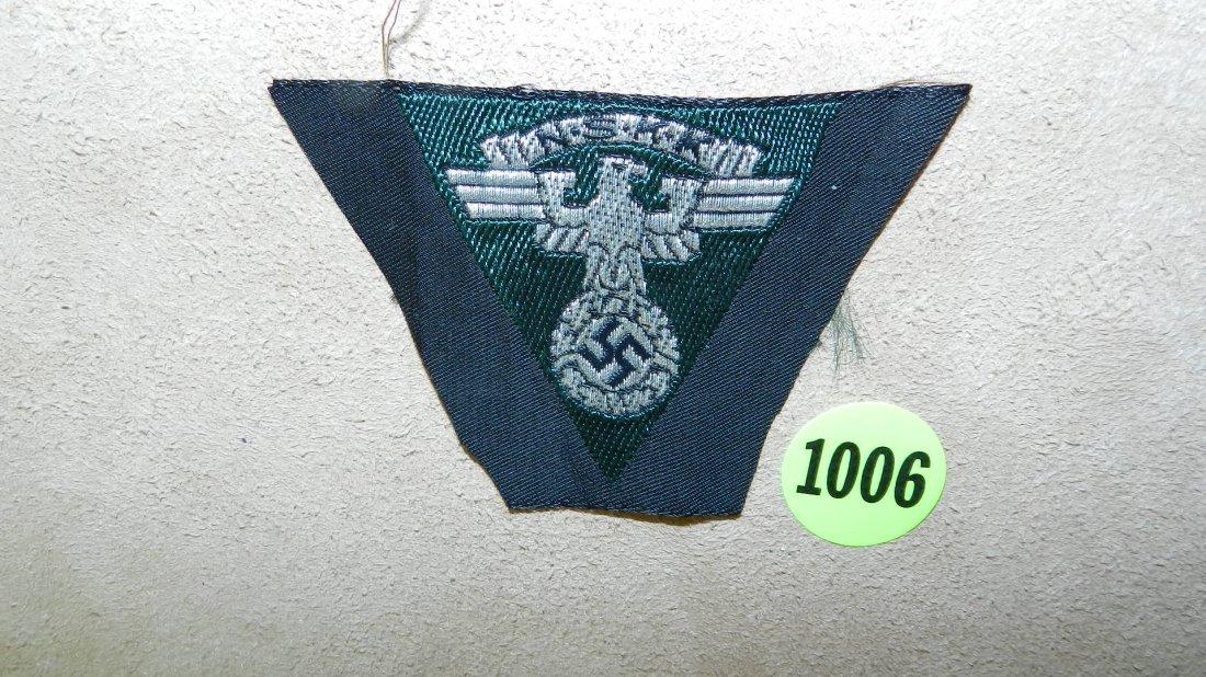 1006: WWII Nazi German N.S.K.K. cap Eagle emblem