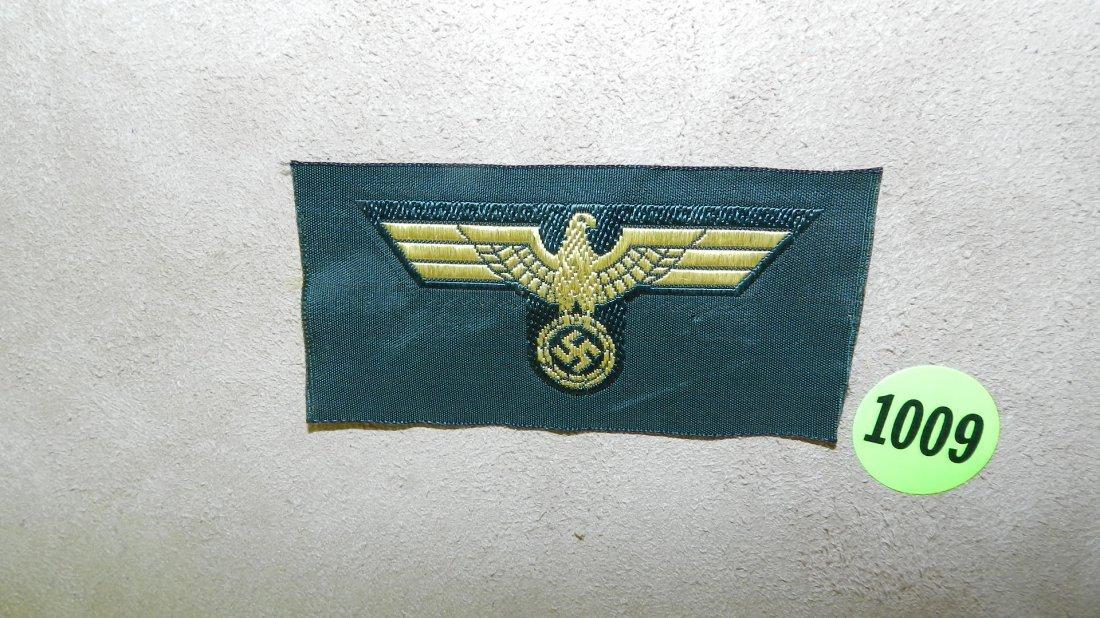 1009: WWII Nazi German cap insignia for coast artillery