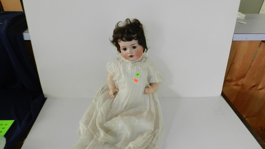 819: antique bisque head doll, as seen