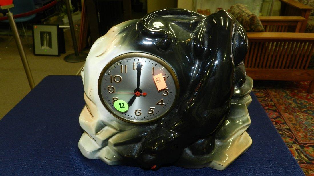 22: mid century black panther on rocks deco clock