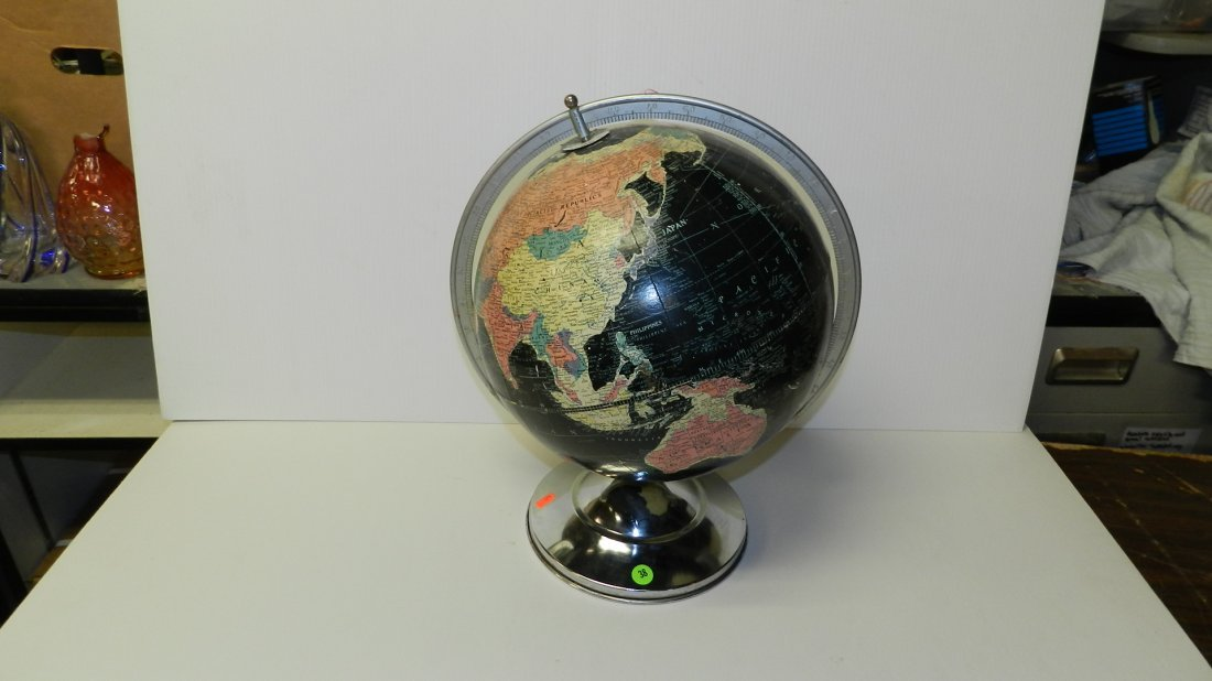 38: mid century chrome globe with black background